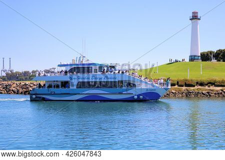 July 6, 2021 In Long Beach, Ca:  Harbor Tour Boat Arriving To The Long Beach, Ca Marina Besides The