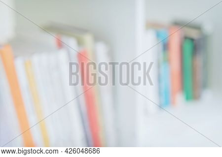 Several Books On The Shelf, Light Blurred Background. Concept Of Learning, School, Back To School, E