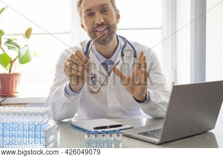 Close Up Portrait Of A Doctor Online Video-call With Patient. Consultation With A Doctor During Quar