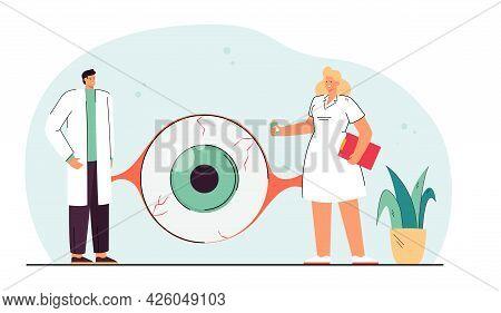 Ophthalmologists Examining Giant Eye Of Patient. Medical Professional Diagnosing Human Visual Organ