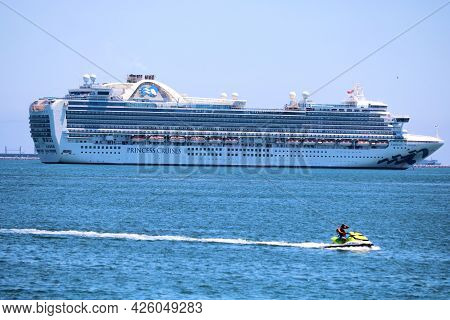 July 6, 2021 In Long Beach, Ca:  Person Jet Skiing Besides Anchored Cruise Ships During The Pandemic