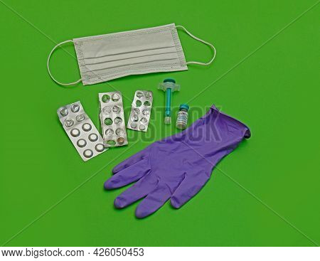 Medicine Pills In Silver Blisters Covid-19 Vaccine And Other Medical Equipment In Laboratory