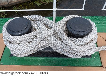 Sea Knot On A Ship Deck Mooring Rope. The Concept Of Travel And Tourism.