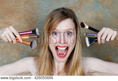 Teenage Girl With Large Eyeglasses Hiding Her Face Behind Open Book