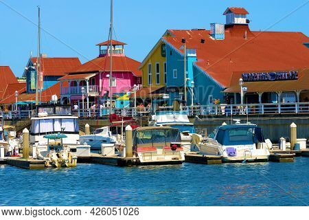 July 6, 2021 In Long Beach, Ca:  Colorful Cape Cod Style Colonial Buildings With Restaurants And Ret