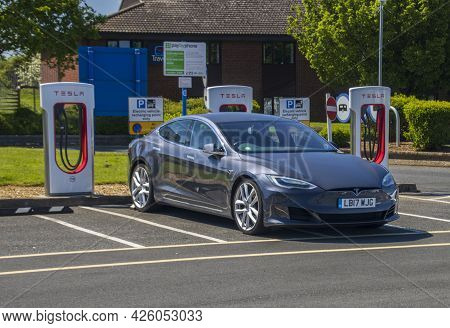 Grantham, Uk - May 30th 2021: Tesla Model 3 In A Super Charger Bay In A Motorway Service Area.