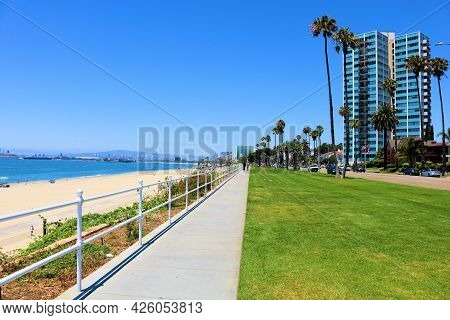 July 6, 2021 In Long Brach, Ca:  Pedestrian Pathway Besides A Manicured Lawn On A Bluff Overlooking
