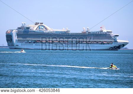 July 6, 2021 In Long Beach, Ca:  People Jet Skiing On The Bay Surrounded By Anchored Cruise Ships Du
