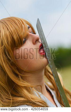 Asian Woman Lick Her Katana Sword.