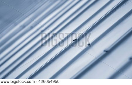Close up shot of corrugated metal sheet on roof of the shed