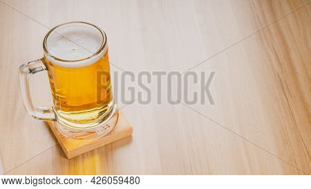 Glasses Of Light Beer, Cold Craft Beer In A Glass On Wood Table