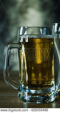Glasses Of  Dark Beer, Cold Craft Beer In A Glass On Wood Table