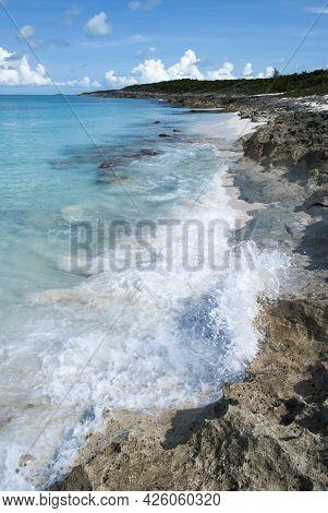 The Scenic View Of Waves Hitting Rocky Beach On Half Moon Cay (bahamas).