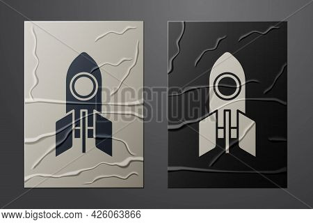 White Rocket Ship Icon Isolated On Crumpled Paper Background. Space Travel. Paper Art Style. Vector