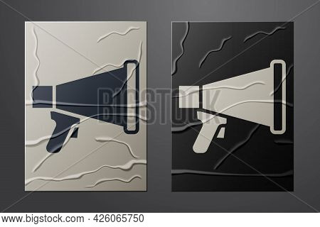White Megaphone Icon Isolated On Crumpled Paper Background. Speaker Sign. Paper Art Style. Vector