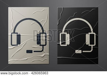 White Headphones Icon Isolated On Crumpled Paper Background. Earphones. Concept For Listening To Mus