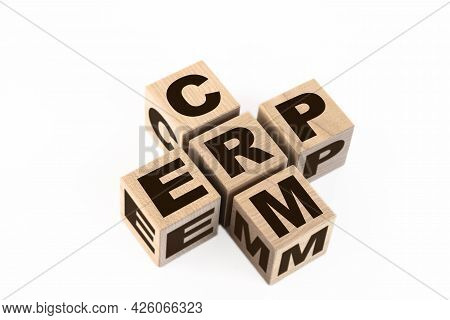 Words Crm And Erp Collected In Crossword With Wooden Cubes. Erp Enterprise Resource Planning, Crm Bu