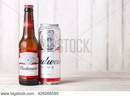 London, Uk - April 27, 2018: Glass Bottle And Aluminium Can Of Budweiser Beer On Wooden Background W