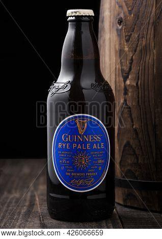 London, Uk - April 27, 2018: Bottle Of Guinness Rye Pale Ale Beer On Top Of Old Wooden Barrel. Guinn