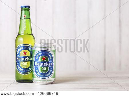 London, Uk - April 27, 2018: Bottle And Aluminium Can Of Heineken Non Alcoholic Lager Beer On Wooden