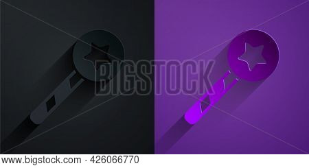 Paper Cut Magic Wand Icon Isolated On Black On Purple Background. Star Shape Magic Accessory. Magica