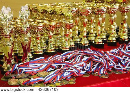Cups And Medals For Awarding Winners In Competitions. Winner Concept