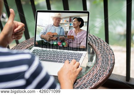 Asian Woman Video Conference Meeting With Sick Elderly Father To Encourage And Inquire About Illness