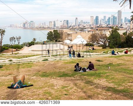 Jaffa, Israel - February 4, 2017: People Relaxing On The Lawn And Admiring The View Of The Tel Aviv