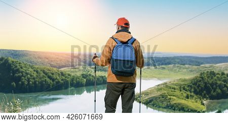 Traveler Man Standing In Summer Mountains At Sunset And Enjoying View Of Nature. Banner.