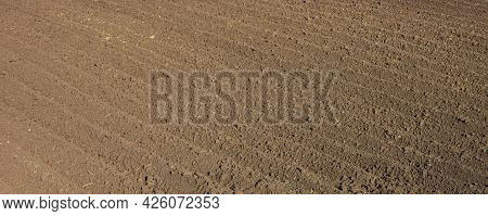 Deep Furrows In The Field After Plowing, Wide View