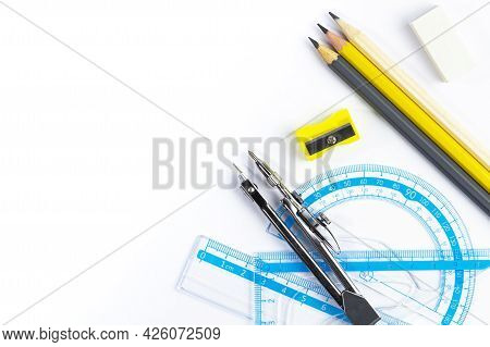 Drawing Supplies Ruler Pencils Compasses As A Frame On White, Concept Of School Supplies Or Drawing
