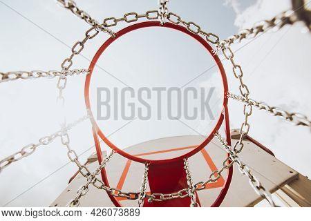 Red Basketball Hoop, Basket Against White Sky. Outside, Street Basketball Court.