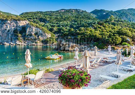 Corfu, Greece. Agios Petros Beach In The Village Of Paleokastritsa.
