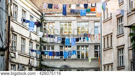 Washed Clothes Drying. Fresh Clean Clothes Are Drying Outside. Clothes Hanging To Dry On A Clothes-l
