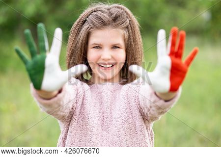 Mexico Flag Painted On Teen Girl Hands, Focus On Smile Face. Mexican Independence Day 16 September.