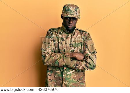 Young african american man wearing army uniform skeptic and nervous, disapproving expression on face with crossed arms. negative person.