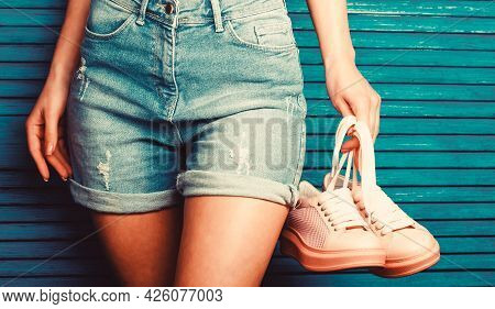 Girl Hold A Pair Of Shoe. Woman Holding Shoes. Woman Holding A Pair Of Pink Shoes. Girl With A Beaut