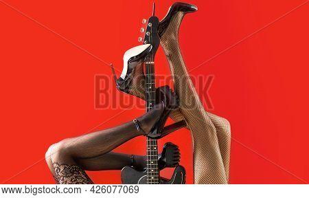 Music Concept. Sexy Legs. Guitar, Electric Guitar. Music Festival, Live Music, Concert. Instrument O