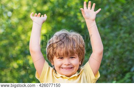 Happy Children Kid Boy With Hands Up. Child Outdoors In Nature. Happy Child. Funny Baby Boy Isolated