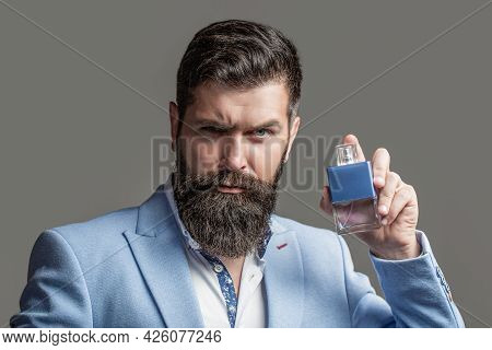 Masculine Perfumery, Bearded Man In A Suit. Male Holding Up Bottle Of Perfume. Man Perfume, Fragranc