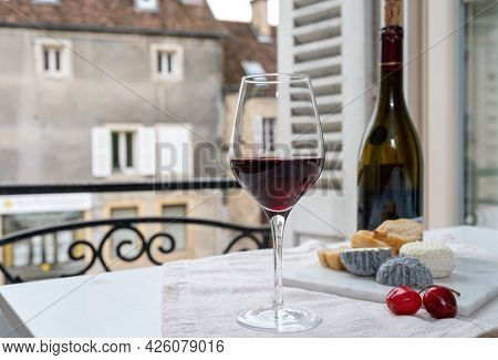 Tasting Of Burgundy Red Wine From Grand Cru Pinot Noir  Vineyards With French Goat Cheeses And View