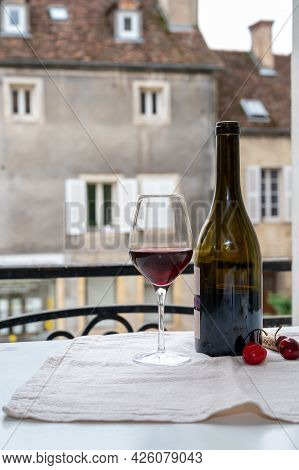 Tasting Of Burgundy Red Wine From Grand Cru Pinot Noir  Vineyards, Glass And Bottle Of Wine And View