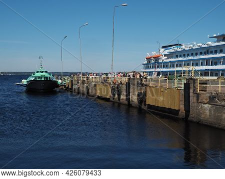 Petrozavodsk, Russia July 6, 2021. Loading Tourists In A Boat For A Trip To The Island Of Kizhi, Kar