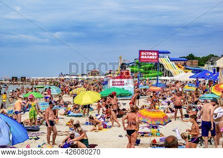 Zaliznyi Port, Ukraine - July 23, 2020: Many People On The Beach At Zaliznyi Port. A Crowd Of Naked