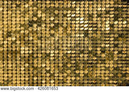 Rows Of Blinking Golden Yellow Brass Metal Plaques Sway In Wind And Shines In Sun And Create Unique
