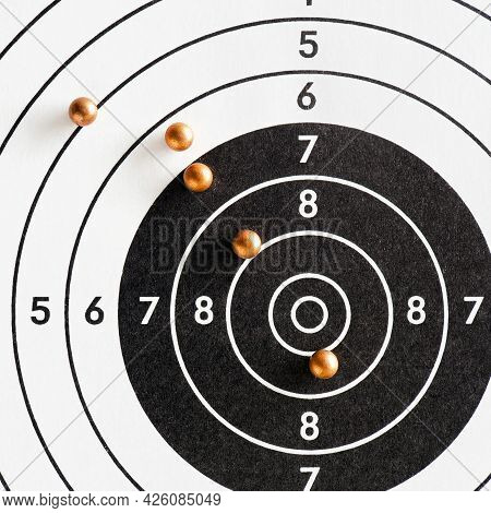 Balls Or Bullets For Pneumatic Shooting Lie On A Paper Target. Square Illustration About Shooting Fr