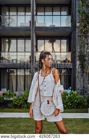 Attractive Woman In Bali Posing Against Mansion