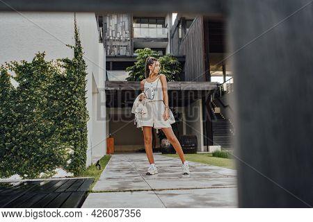 Stylish Woman With Dreadlocks Posing Against Mansion