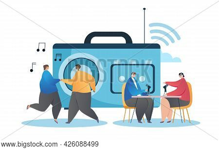 Concept Of Working On The Radio. A Female Presenter Interviews An Invited Guest. The Couple Is Danci