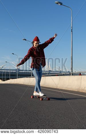 Cheerful Hipster Girl Skateboarding On City Road Happy Enjoy Longboard Riding. Young Woman Of 20s We
